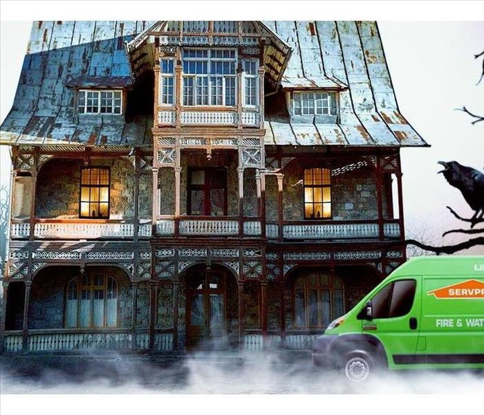 Graphic image of haunted house with SERVPRO van in front